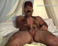 His cumshot is lying down and his eyes pinched at his orgasm. His cum ends up in his bush. The Video is over 30 Years old.