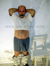 Hueseyin - a very hairy turkish Bear and is Handcuffing a Prisoner.