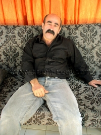 A turkish bear with a totally hairy body wanks naked and has an intense orgasm.