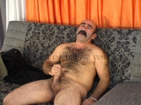 His orgasm is sitting and he is breathing loudly. His cumshot is very intense and can be seen from two camera positions.