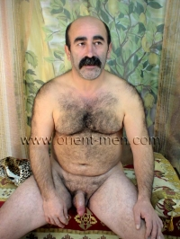 A naked older turk with a very hairy body and a big mustache jerks off in a turkish gay video. His body is hairy like a bear,