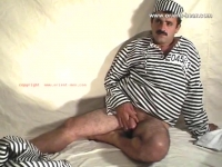 Then he is naked downstairs. His cock is a normal size and gets pretty hard.