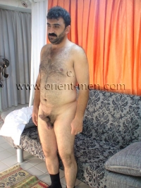 A young naked hairy kurdish bear with a rock hard cock and an orienatal face seen in a hot turkish gay video. His body is somewhat strong and beautifully hairy.