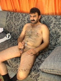Then he strips naked, already when he takes off he has a hard cock. He also shows his hairy butt briefly. His cumshot is sitting.