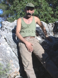 A kurdish man with a long cock wanks naked in the mountains
