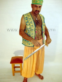 In this turkish gay video he wears old turkish clothes.