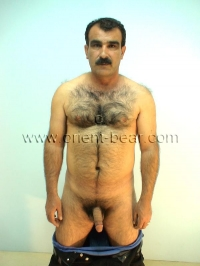 In this turkish gay video he is standing in the studio with street clothes and strips naked and shows his perfect body.