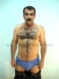 A young haired kurdish man shows naked his perfect body an his very hairy ass in the dog position seen in a turkish gay video.