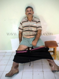 A strong turkish farmer in rubber boots strips naked and jerks hard cock and his cum lands on his rubber boots in a turkish gay video.