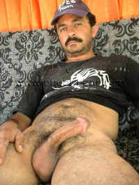 He has a sexy face with a horny mustache.
