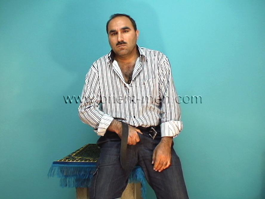 go to this turkish gay photo series. A naked very hairy turkish man shows his hard, plump hairy buttocks in doggy style in a turkish gay video. His body is strong and has fur as body hair. His face is oriental and sexy with a horny mustache. His cock is thick with a big cockhead and he has a bush. In this turkish gay video he is in street clothes in the studio. He strips naked and does his show.