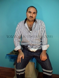 In this turkish gay video he is in street clothes in the studio.