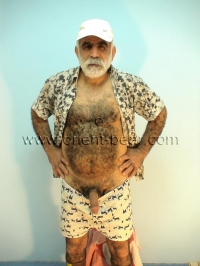 An older turkish man with a full hairy body and a very big cock