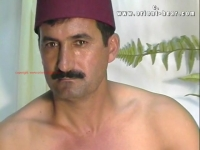An erotic naked turkish man has an aggressive orgasm in a turkish gay porn video. His body has no hair, because he often shaves it. His face is very erotic and has an oriental look with his mustache.