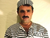 Arif - a strong haired turkish man as a prisoner with handcuffs. (id116)