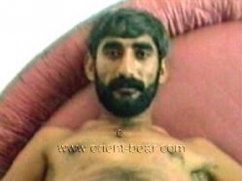 Ismael M. a naked kurdish man with sexy face masturbates in his bed. (id1001)