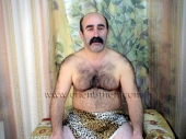 Hueseyin - a naked older turk with a very hairy body and a big mustache jerks off in a turkish gay video. (id106)