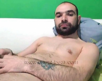 Reyhan - a Turkish Gay with a monster big cock does a great Asshole Show and Cumshot in Doggy Position