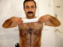 Hasan B - a kurdish man with a very erotic face strips naked and shows his totally hairy body. (id195)