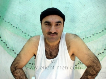 Abbas - a strongly very hairy turkish man in rubber boots in a turkish gay video. (Id31)