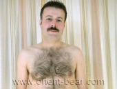 Hakan S. - a very Hairy Turk with a very big Cock and a big black Bush in a Turkish Gay Video. (id315)