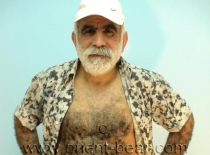 Ibrahim M. - an older turkish man with a full hairy body and a big cock jerking off on a rubber boot in a turkish gay video. (id36)