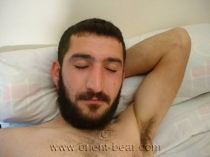 Mert - a kurdish man wanks naked in the bed his big cock to see in a turkish gay video. (id373)