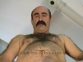 Hueseyin - a turkish bear with a totally hairy body wanks naked and has an intense orgasm in a turkish gay video. (id43)