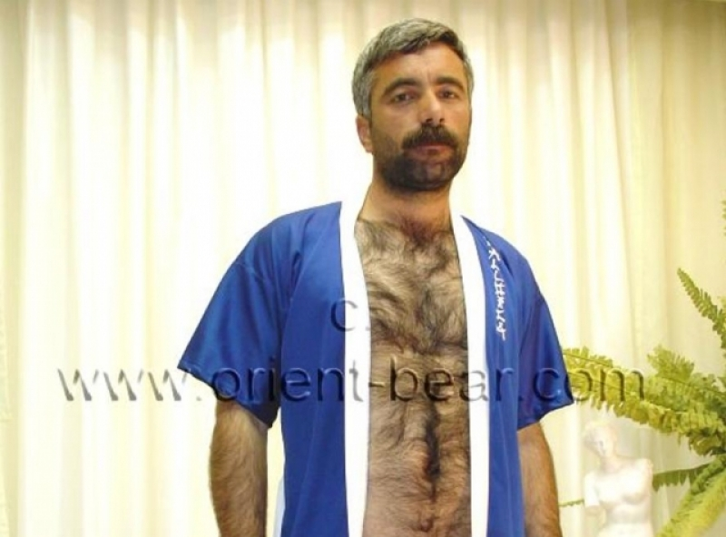 Serdat E. - is a very hot naked kurdish man with fur as bodyhair and a very hard cock in a turkish gay video. (id469)
