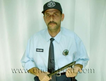 Pala - is a half naked turkish man with very hairy body and a stone hard cock in police uniform. (id549)