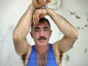 Sefer - a young turkish bear with a thick cock and huge big balls in handcuffing in a turkish gay video. (id671)