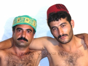 Ali S. + Hakan Y. - two naked kurdish men fucking in the dog position in a kurdish gay video. (id677)
