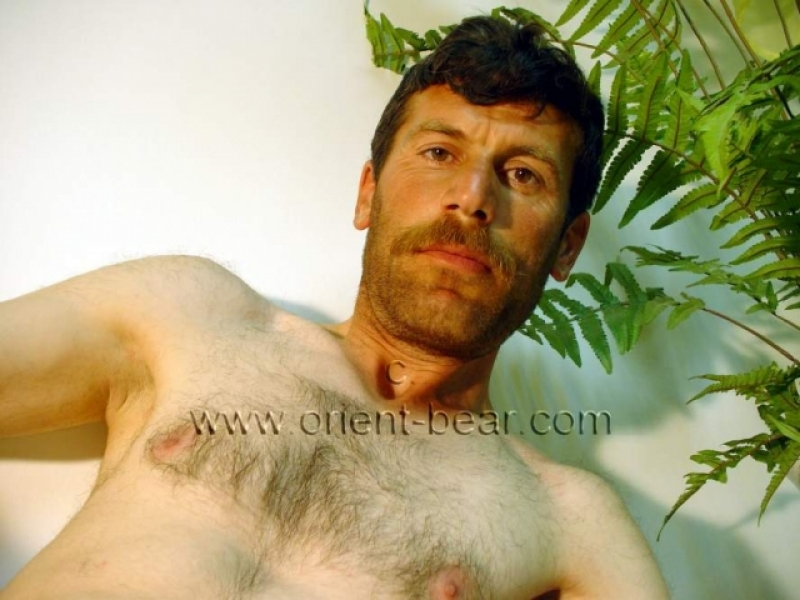 Erol - a young naked kurdish farmer show his hairy ass crack in doggy style  seen in a very hot turkish gay video. (id834)
