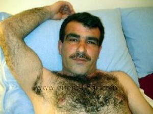 Safak - a hairy kurdish man lies naked in bed