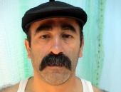 Hueseyin - a turkish construction worker with a heavily hairy body and an oriental face with a thick mustache. (id982)