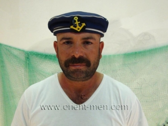 Halif - is a hairy naked turkish bear with a big thick cock in a turkish gay video. (id994)