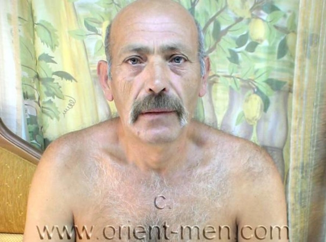go to this turkish gay photo series. A turkish gay video with a big older turkish daddy with a totally shaved big cock with a big cock head jerks nacked. His face is a bit older, it looks oriental and he has a mustache. In this turkish gay video he sits and lies naked on an ottoman and jerks off. His body is big and strong and he has normal body hair. He also leans forward and shows his hot ass cheeks with the hairy crack. The camera shows everything from below.
