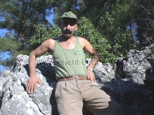 A kurdish man with a long cock wanks naked in the mountains in a turkish outdoor gay video. He has a very erotic oriental face with a thick mustache. His cock is beautiful long and he gets very hard. In this kurdish gay video he plays a turkish soldier in the nature undresses naked and masturbates one.