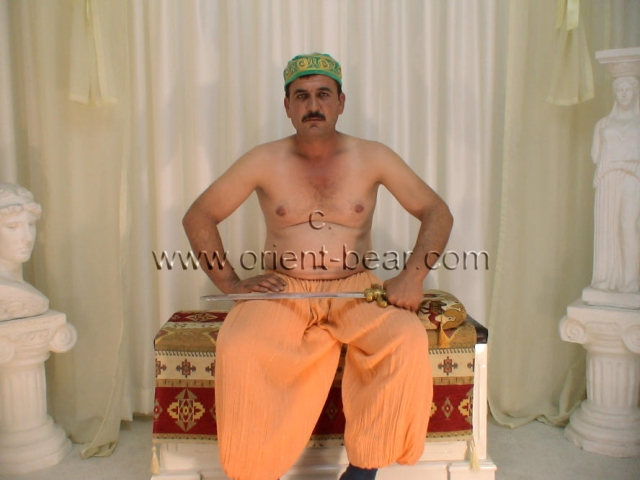 go here to this turkish gay photo series. A naked turkish farmer from the mountains with a lot of sperm at the cumshot in a hot turkish gay video. His body has very smooth skin and has very little hair. His cock is normal size, is very hard  and his bush is totally shaved. I took him as a model because he has a very nice erotic face with a nice mustache and it was something new with the hairless body. In this turkishn gay video he wears old turkish clothes and masturbates in the studio.