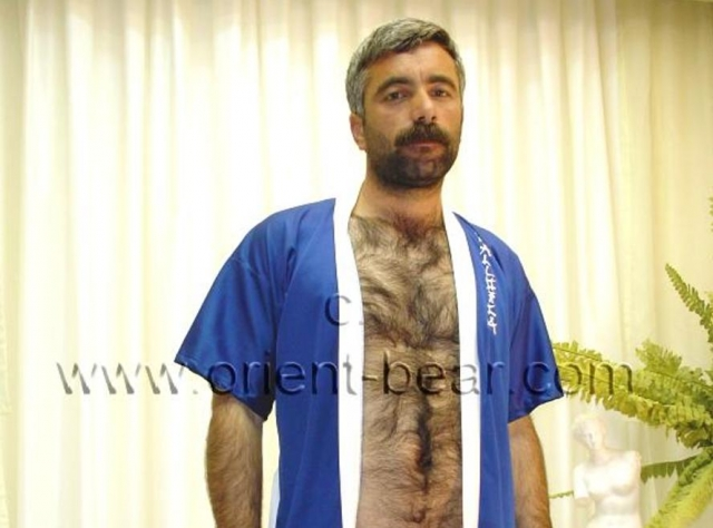 go here to this turkish gay photo series. A very hot naked kurdish man with fur as bodyhair and a very hard cock in a turkish gay video. He is a sex addict and has to fuck or masturbate at least 5 times every day. He always jerks when he is alone and has time. His body is as full of hair as a monkey. He is a real turkish bear from the orient in a turkish gay video. His cock is rock hard and also has the full bush. His plump ass cheeks are hairy and the ass crack is so full of hair that you can not see the asshole.