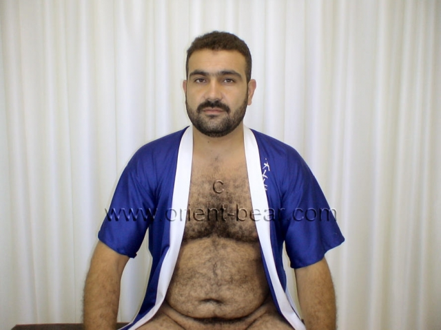 A very hairy turkish bear with a horny cock with a big cack head and an intense orgasm. His body is horny and hairy from head to toe. His face is very oriental and very erotic and he has a sexy mustache. His cock has a normal size, his bush is trimmed, he is pretty stiff and has a very big glans. He jerks naked on a bench and has his legs apart, while you can see his fully hairy ass crack.