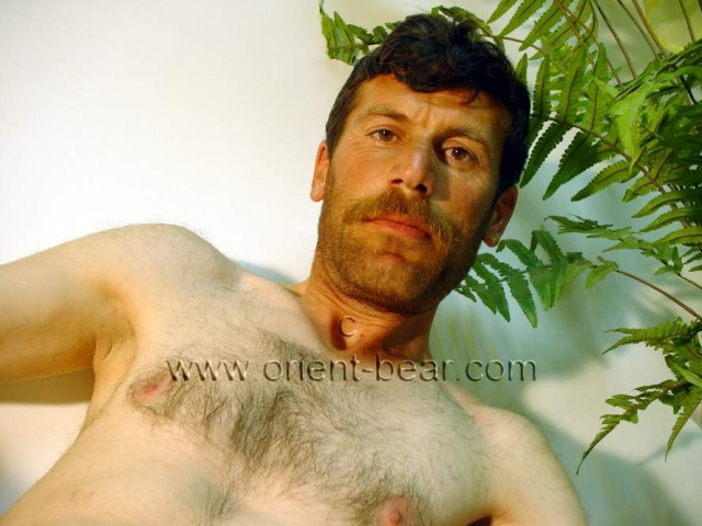 go to this turkish gay photo series. A young naked kurdish farmer with perfect body show his hairy ass crack in doggy style seen in a very hot turkish gay video. He is a sexy young naked kurdish man with a dark brown body hair and a very hairy ass crack. His body is perdect, looks very sexy. Its cock and his balls are horny totally shaved. He also shows his firm butt cheeks with his hairy ass crack in doggy style. In this turkisdh gay video        he sits almost naked in the studio in an antique decoration.
