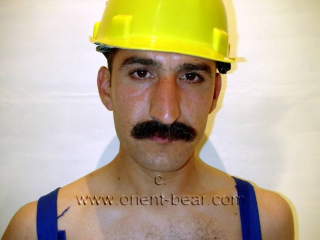 A kurdish turkish worker with a big cock like a gavel and a thick mustache. His face with the mustache is very oriental. His body is tall and tough and normal haired. His cock is very big and thick and has a big black bush. go here to this photoseries.