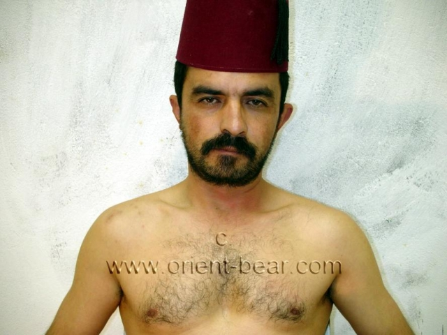 Suat M. a young naked turkish man masturbates in the garage. He has a hairy body with a trimmed bush. His cock has a normal length with a big cock head.