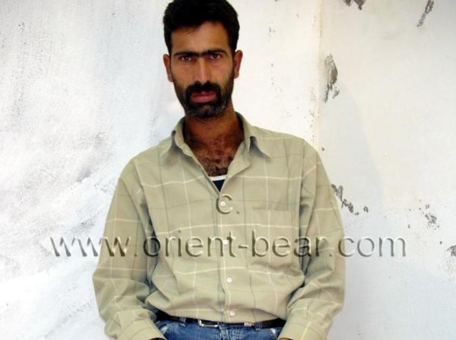 A Naked Kurdish Prisoner with fur as Body Hair and a long big Cock in a Kurdish Gay Video.