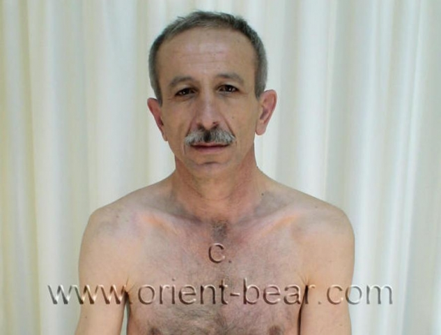 go to this turkish gay photo series. In this turkish gay video you see a naked older turkish daddy with a long, big and very hard cock. His body is tall and slender and has normal hair. He has a distinctive older oriental face with a mustache. His cock is bone hard, long, big and he is always straight up. He shaved his pubic hair and scrotum totally smooth. In this turkish gay video he sits on a bench with a towel. He plays something on his cock and he is hard. He jerks in some positions and his cumshot is wide-legged over a bank.