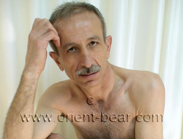 Erdogan B. - an older turkish daddy with a big hard cock wanks naked in a turkish gay video. He has a tall, slim body with little body hair. His face is oriental with a mustache and is older. In this turkish gay video he sits naked in the studio and already has a stiff cock. He has a very nice big hard cock with a totally smooth shaved bush.  go to this turkish gay photo series